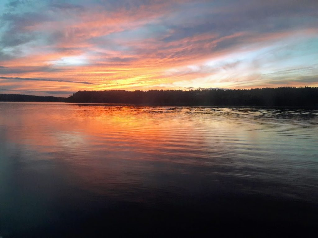 view of sunset at Lake Olypmpia from the Coast Starlight